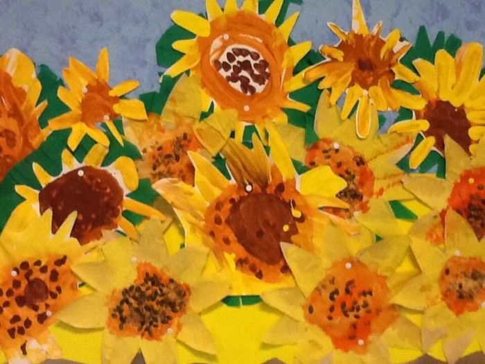 Van Gogh's sunflowers recreated through paint and collage by red class.
