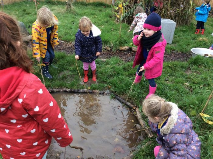 'Fishing' in the puddles.