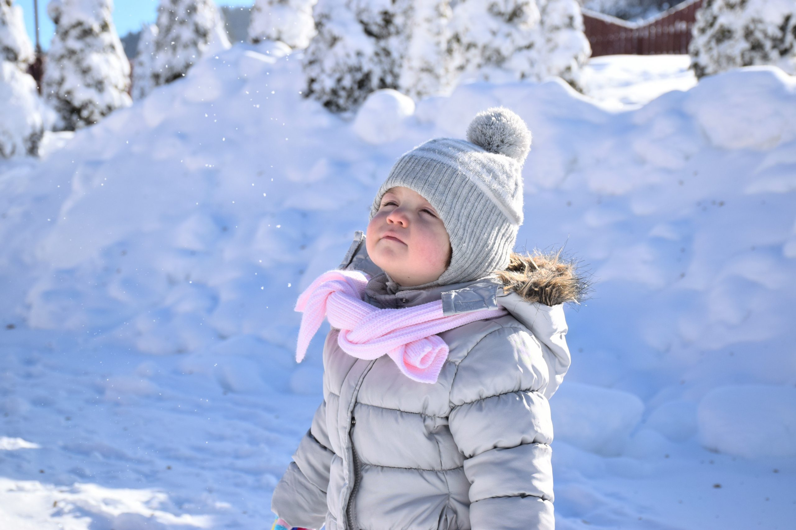 Small child in puffy winter ski jacket