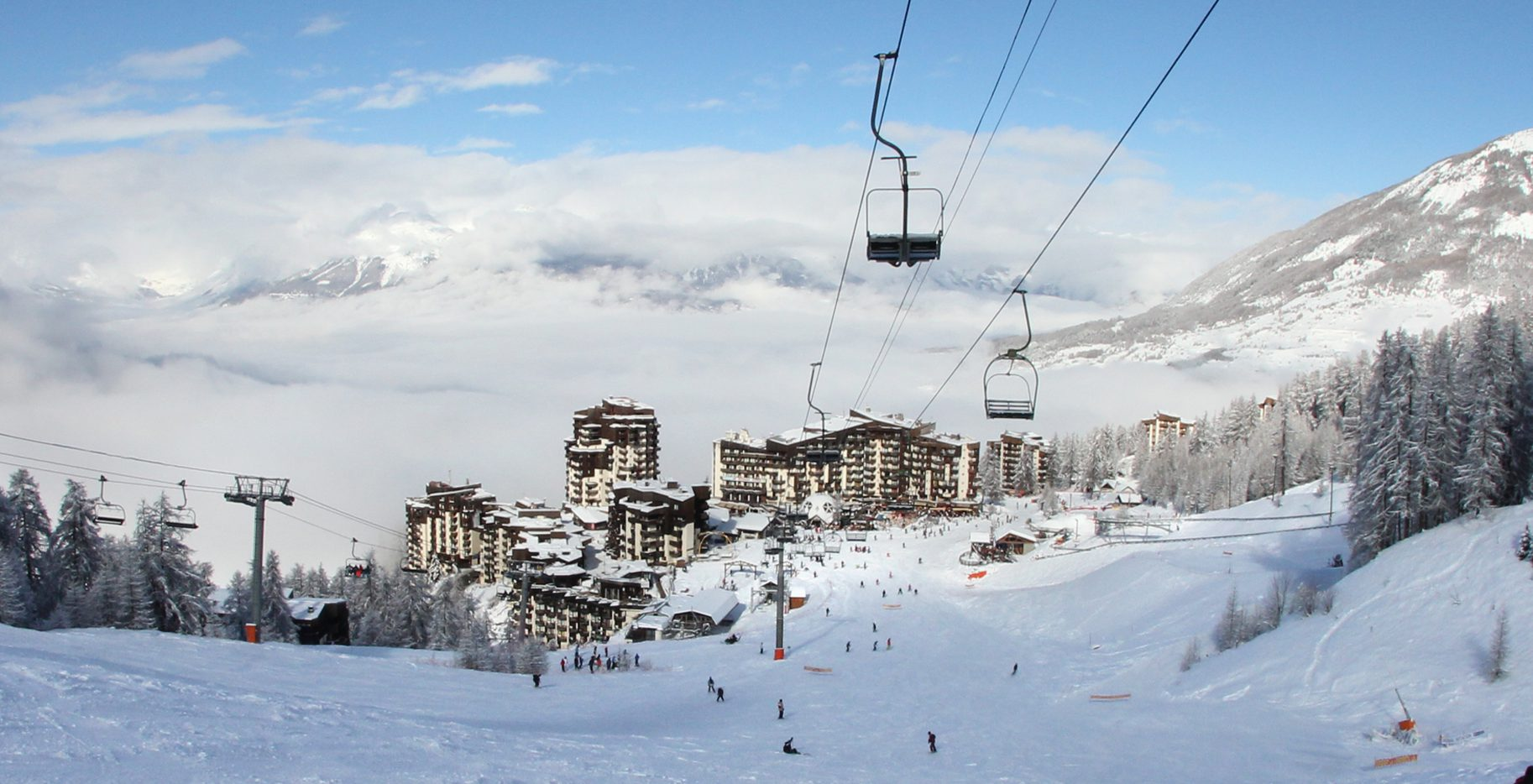 A view looking back at the village of Les Orres from a ski lift