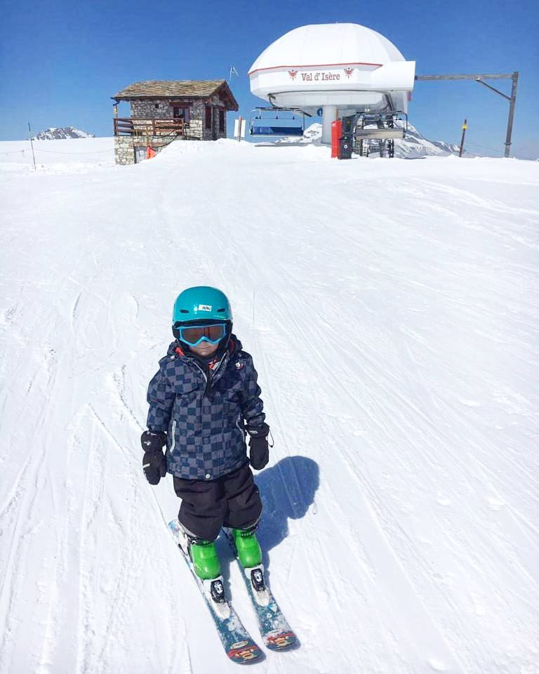 Young child skiing on the Grand Pre green piste in Val d'Isere