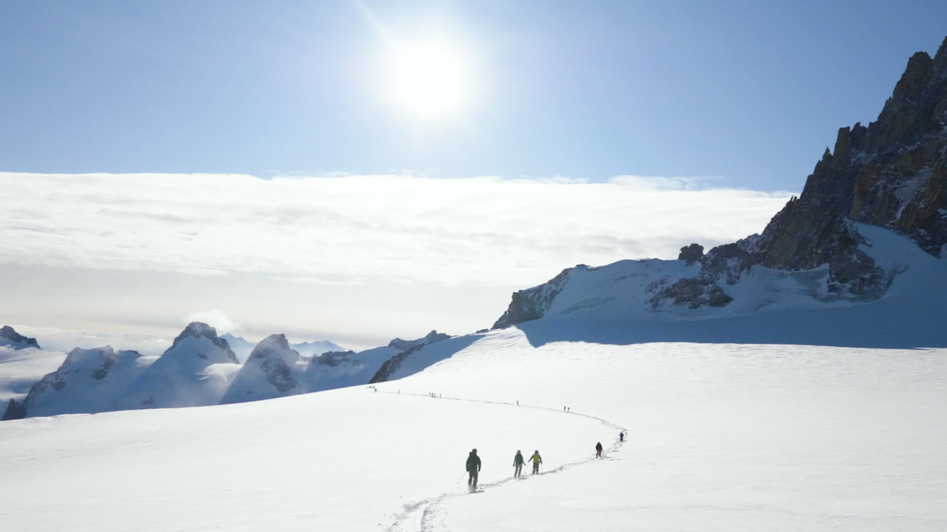 Skiers head towards the entrance of the Voie Normale route of the Vallee Blanche in Chamonix
