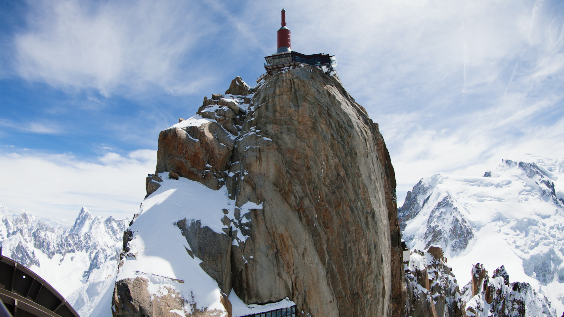 High above Chamonix, the needle of the Aiguille du Midi lift station sits in the sky at 3842m
