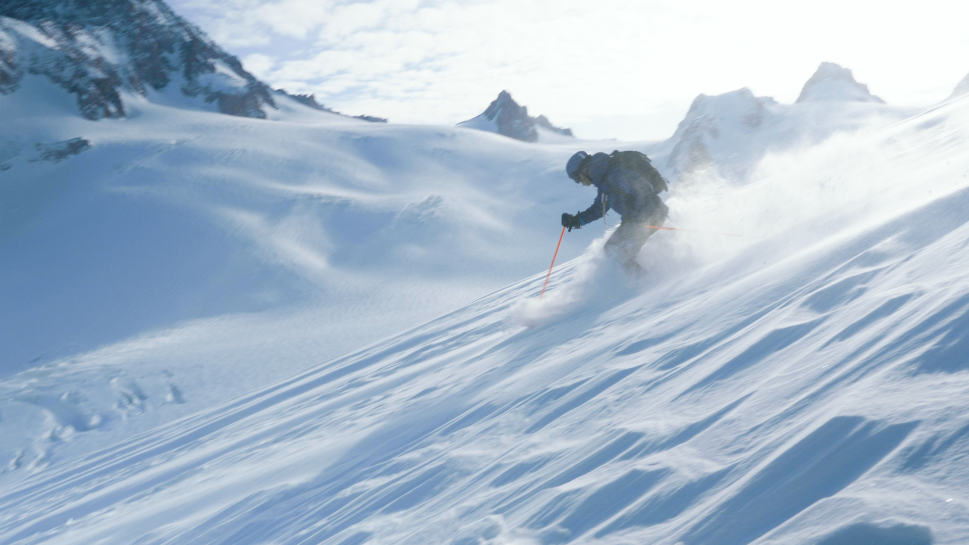 A skier enjoys fresh powder in Chamonix's Vallee Blanche