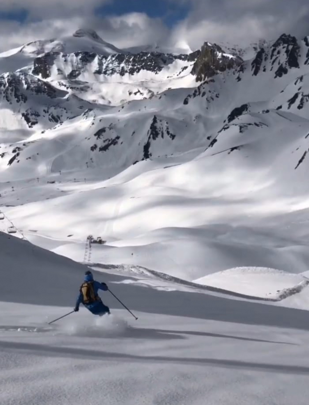 man skiing on untouched snow