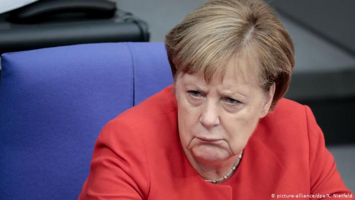 angela merkel frowns whilst announcing ski resort closure