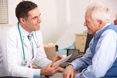 A doctor talking with a patient.