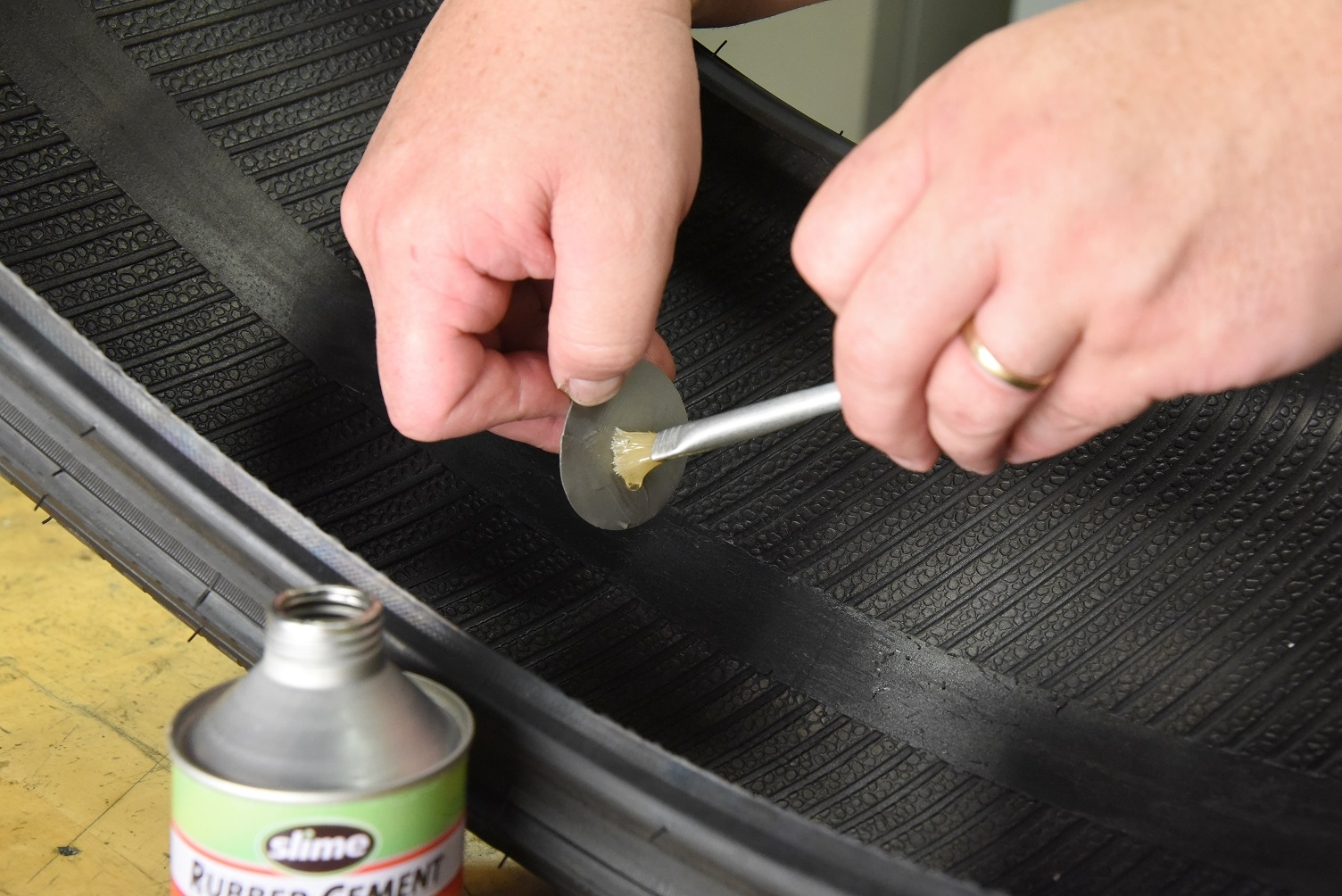 Rubber cement to patch a tire