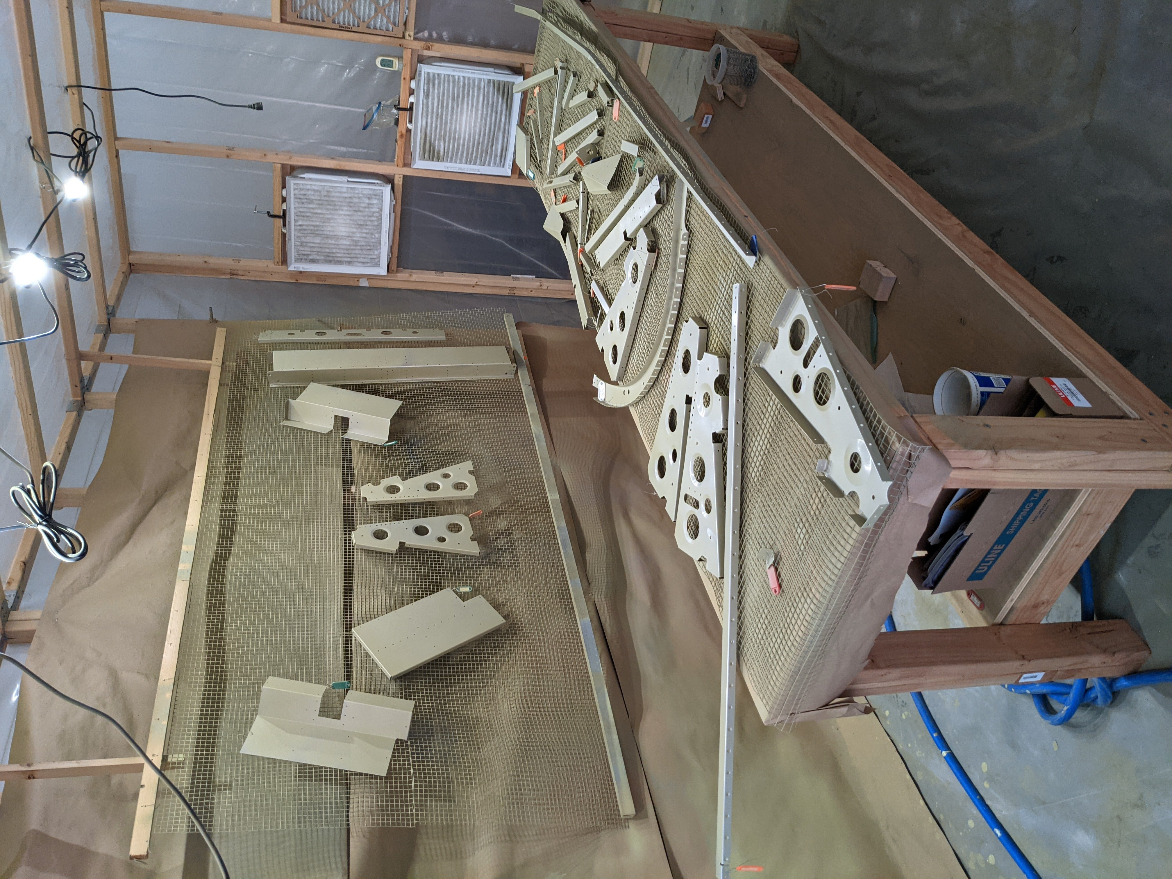 picture of primed parts in paint booth
