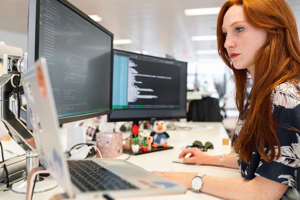 Red-haired woman coding - Photo by ThisisEngineering RAEng on Unsplash