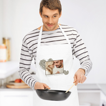 Man wearing personalised apron with message for girlfriend