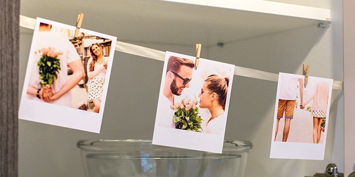 Photo display wire with retro prints in kitchen cupboards