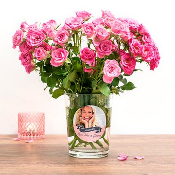 Bouquet of pink roses in a vase with personalised sticker