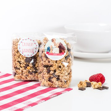 Small plastic bags with granola and personalised stickers