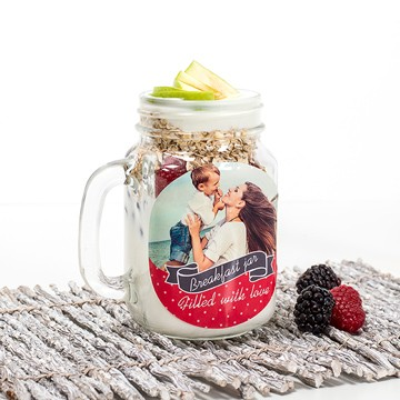 Jar with yoghurt, berries and oatmeal with personalised sticker for mother