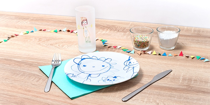 Frosted glass and kids plate with kids drawing on them