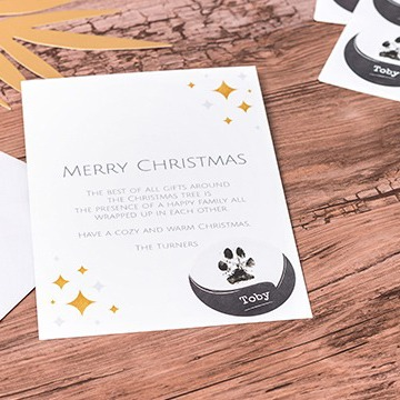 Sticker with dog paw on card