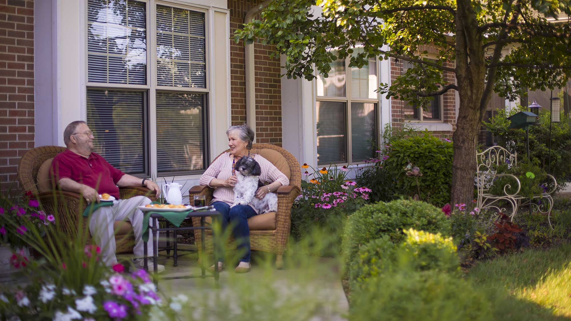 A retired couple sit on the porch of their senior apartment in Orland Park IL