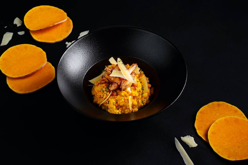 Pumpkin risotto with rabbit confit photo