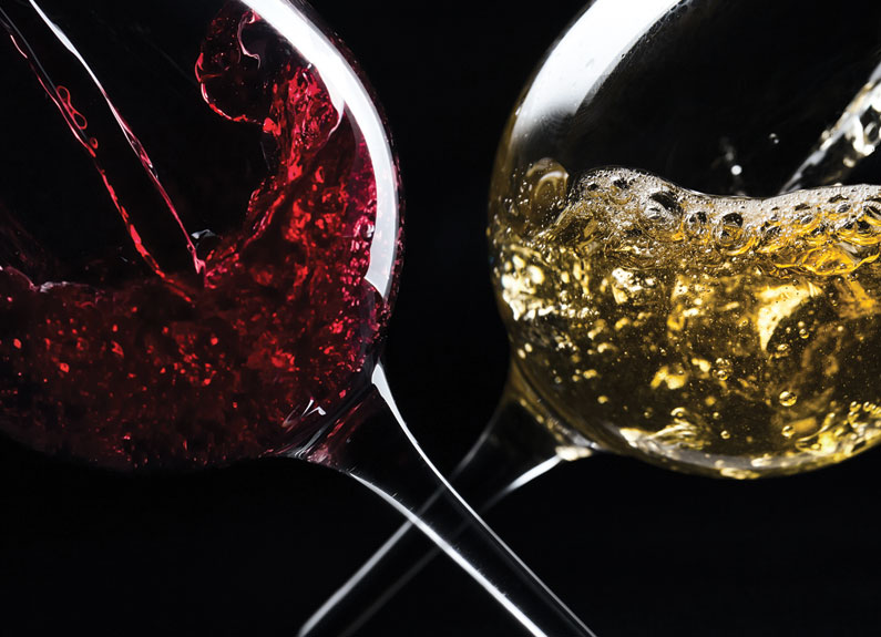 a glass of red wine and a glass of white wine crossed at the stems