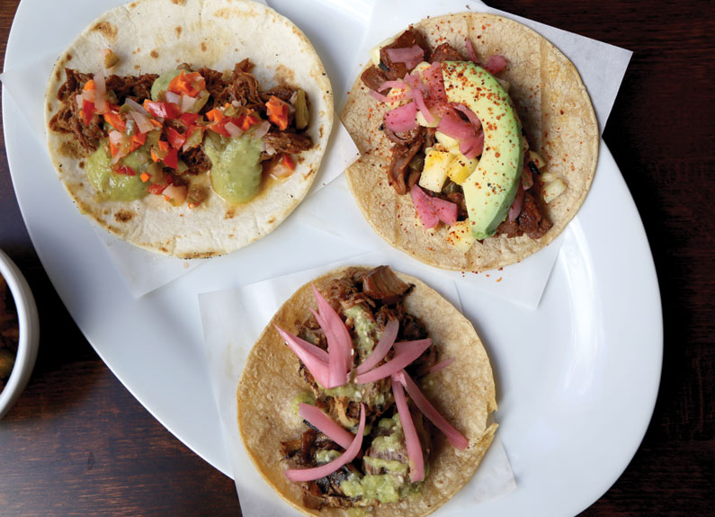 three tacos on a plate at gringo downtown