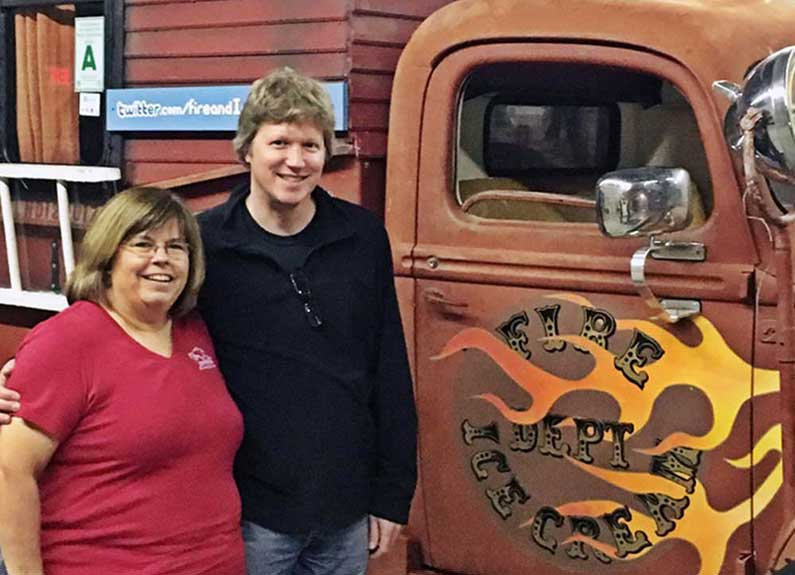 From left, Beckie Jacobs and Matt Armstong are the new owners of the fire and ice cream truck
