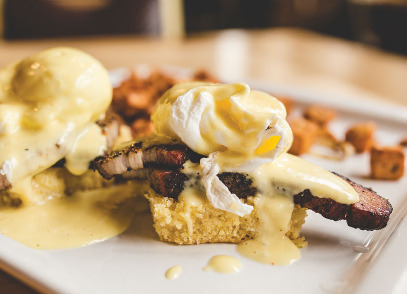 two eggs benedict with brisket and hollandiase