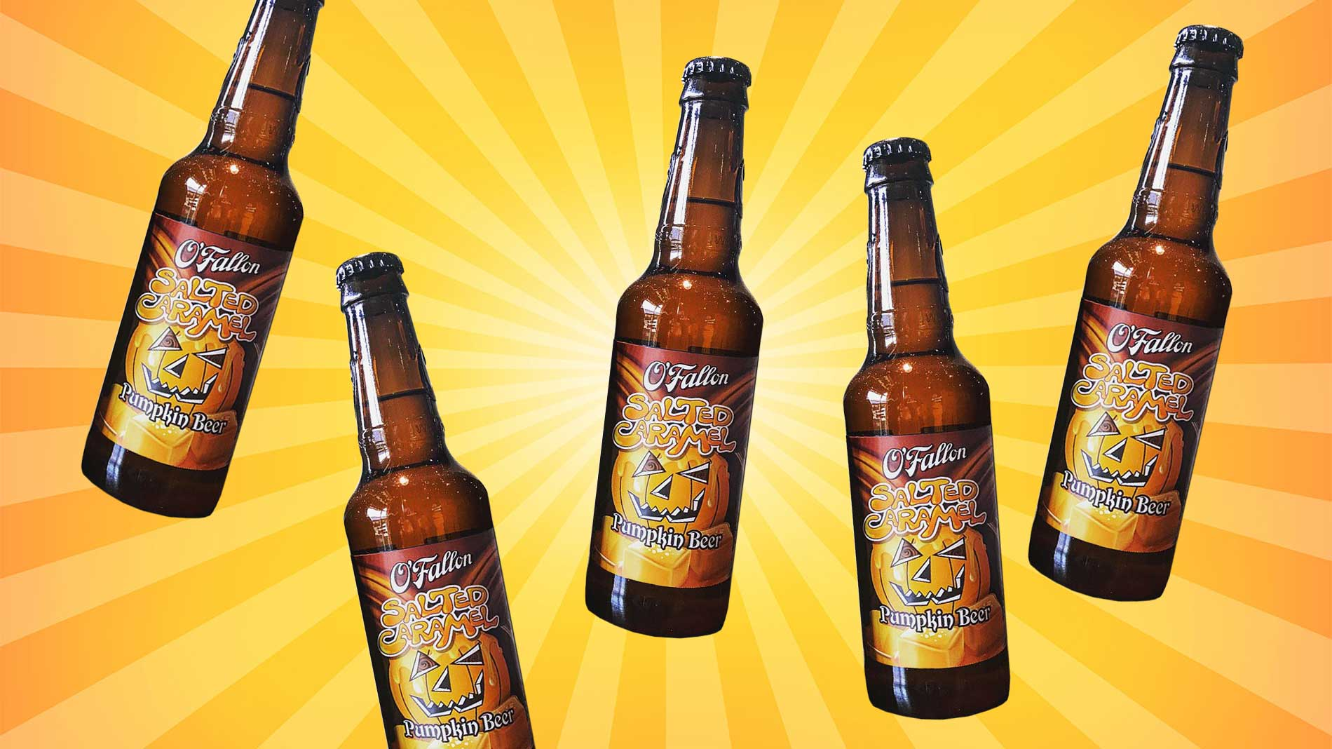 bottles of o'fallon salted caramel pumpkin ale on an orange and yellow striped background