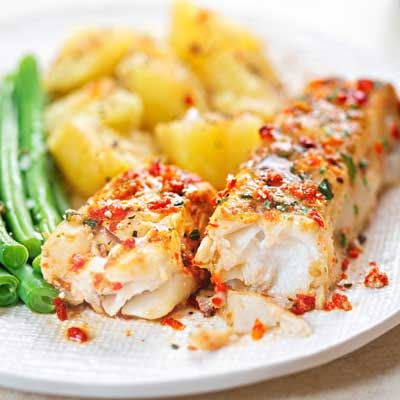 baked fish fillet with red chimichurri