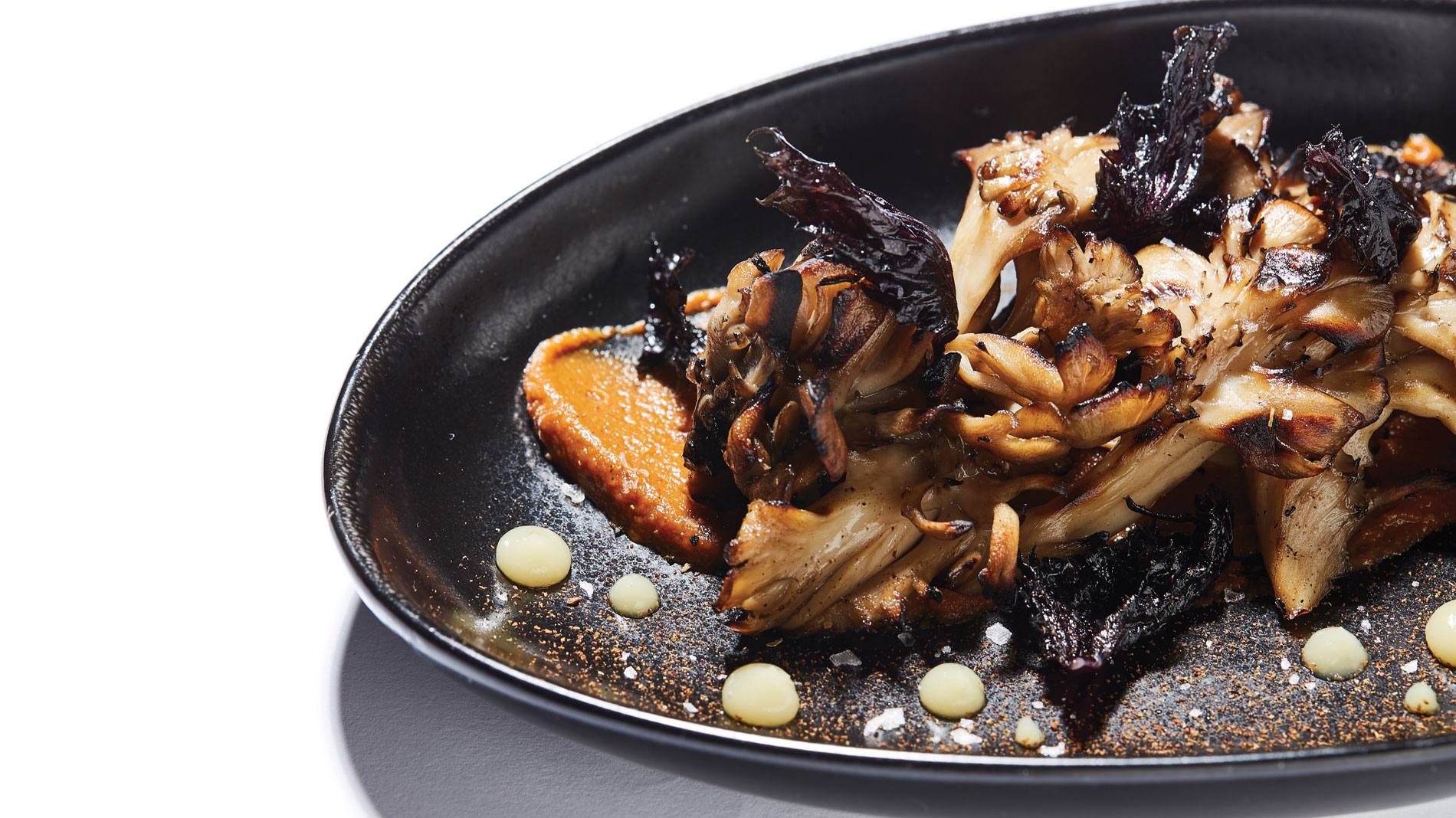 hen of the woods mushrooms on a black plate at good fortune in st. louis