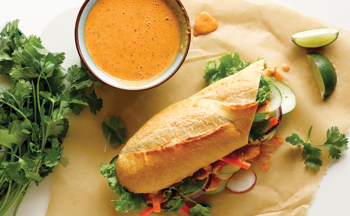 banh mi sandwich with a side of nuoc cham sauce