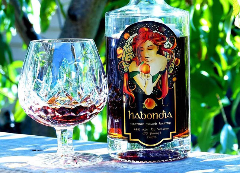 a bottle of habondia peach brandy