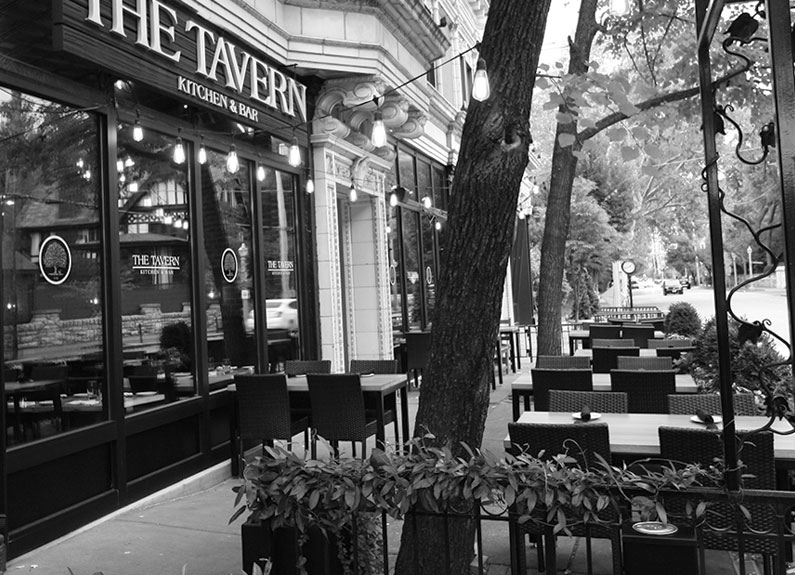 a black and white photo of the tavern in the central west end