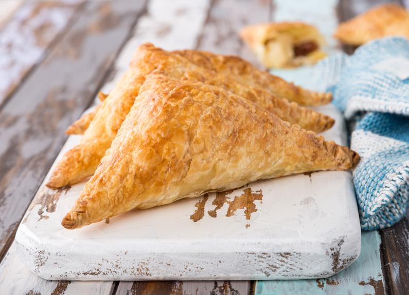 apple cheddar turnovers on a serving board
