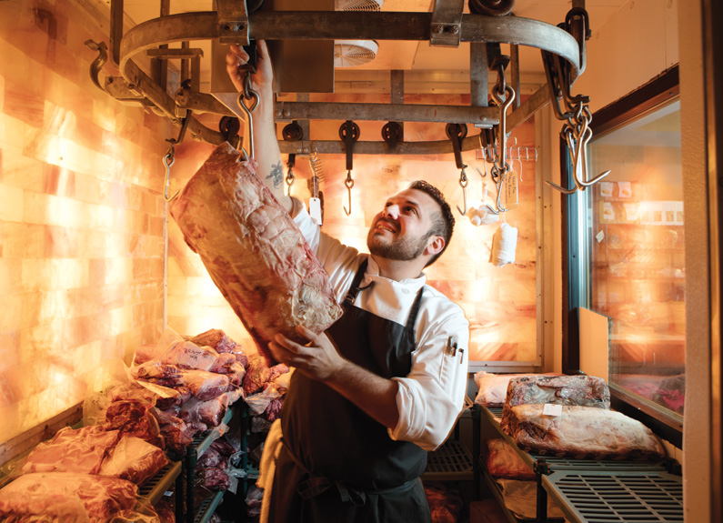 truffles butchery executive chef eric tirone hanging meat in a salt room