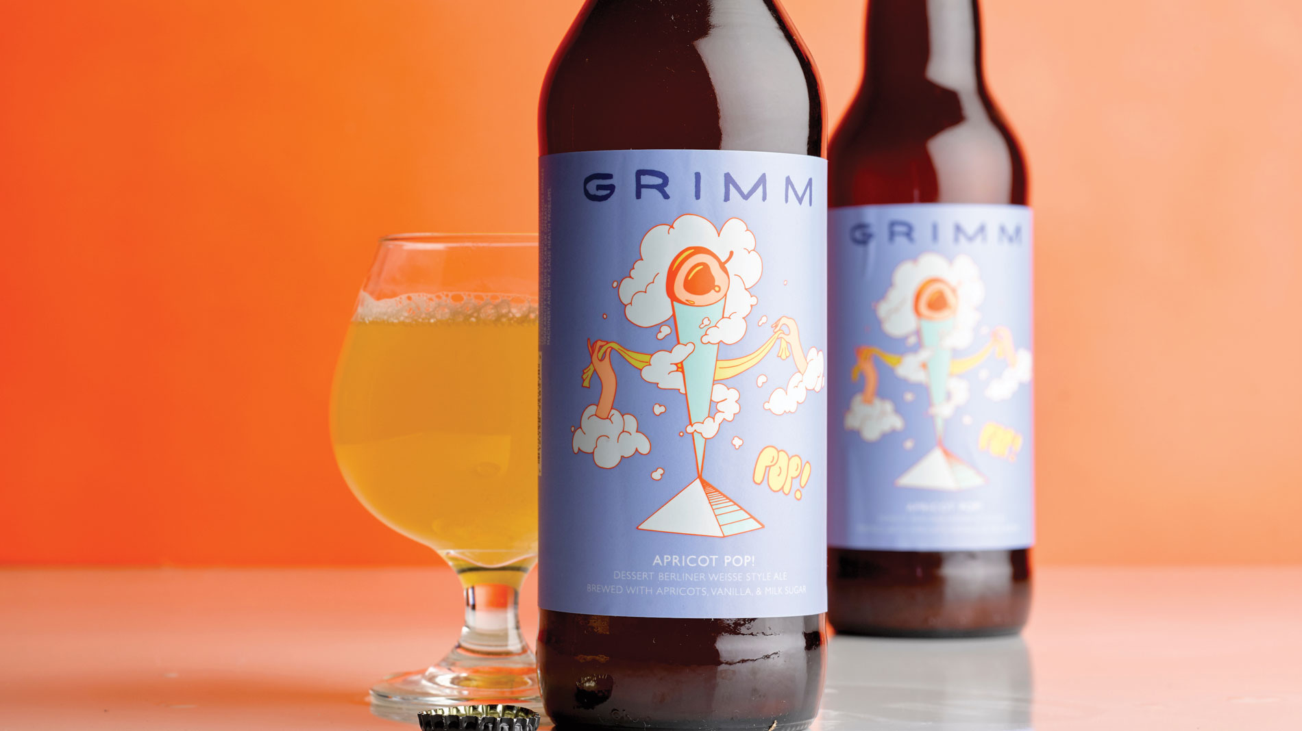 two bottles and a glass of grimm artisanal ales apricot pop beer