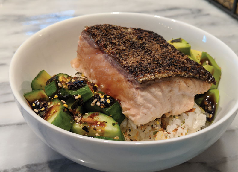 broiled salmon fillet atop a sushi bowl