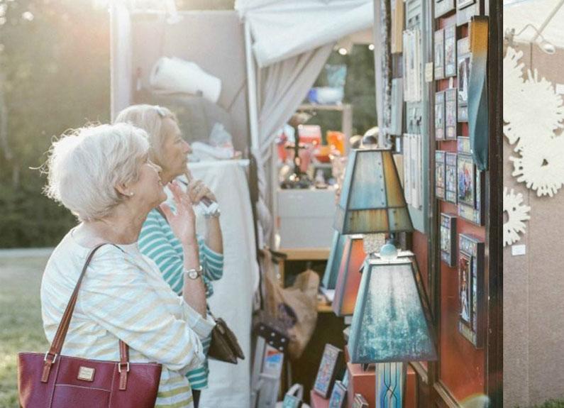 guests at laumeier sculpture park's annual art fair view art