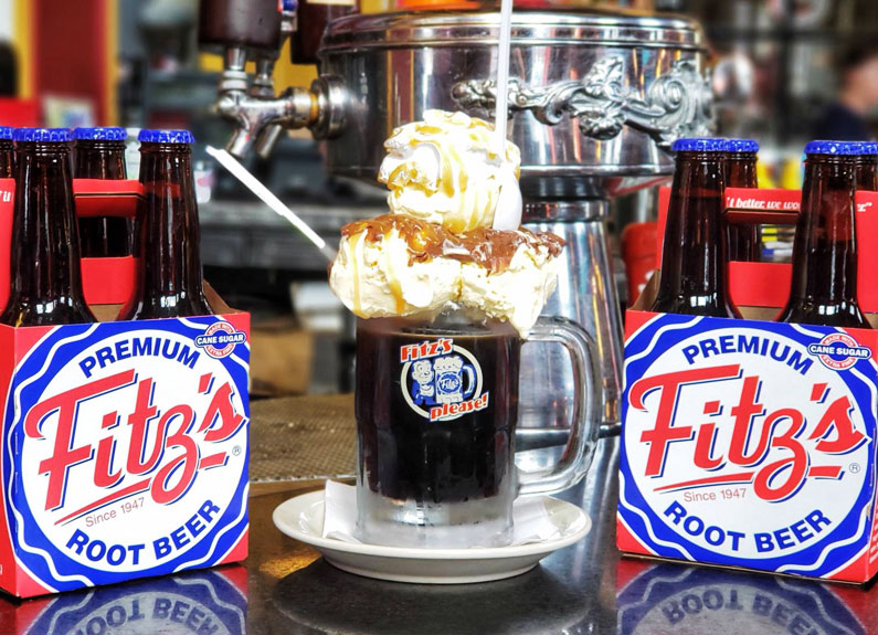 fitz root beer float and four-packs of root beer bottles