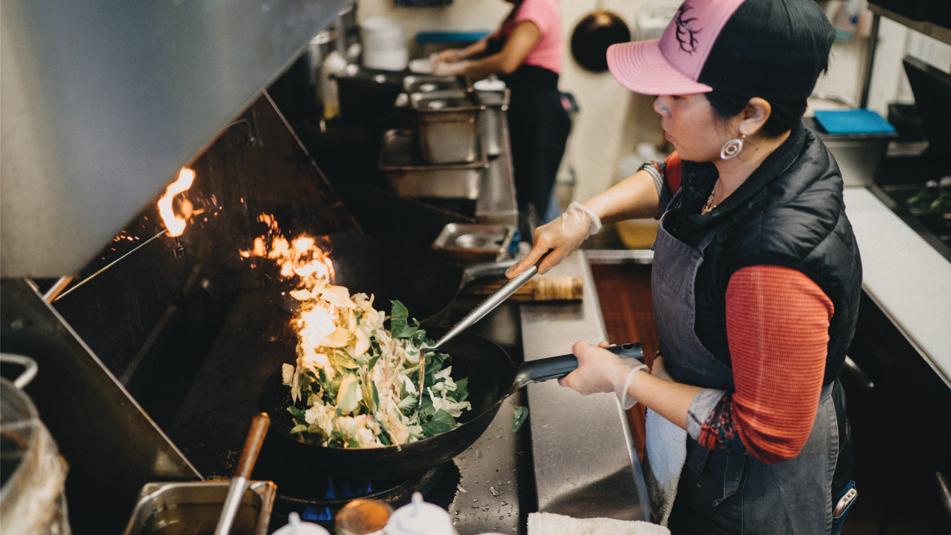 lona's lil eats chef-owner lona luo cooks with a wok at her st. louis restaurant