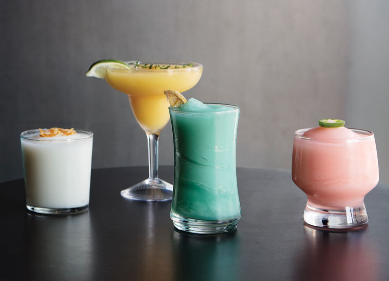 narwhal's crafted frozen cocktails from left, elderflower gin fizz, golden mango margarita, thai collins and rhubarb paloma