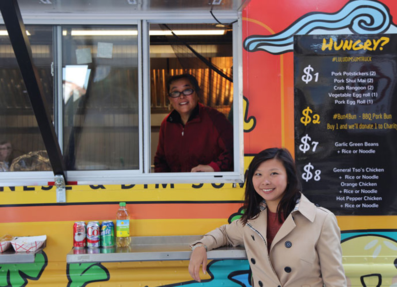 Julia Li and her mother in front of LuLu Seafood and Dim Sum food truck