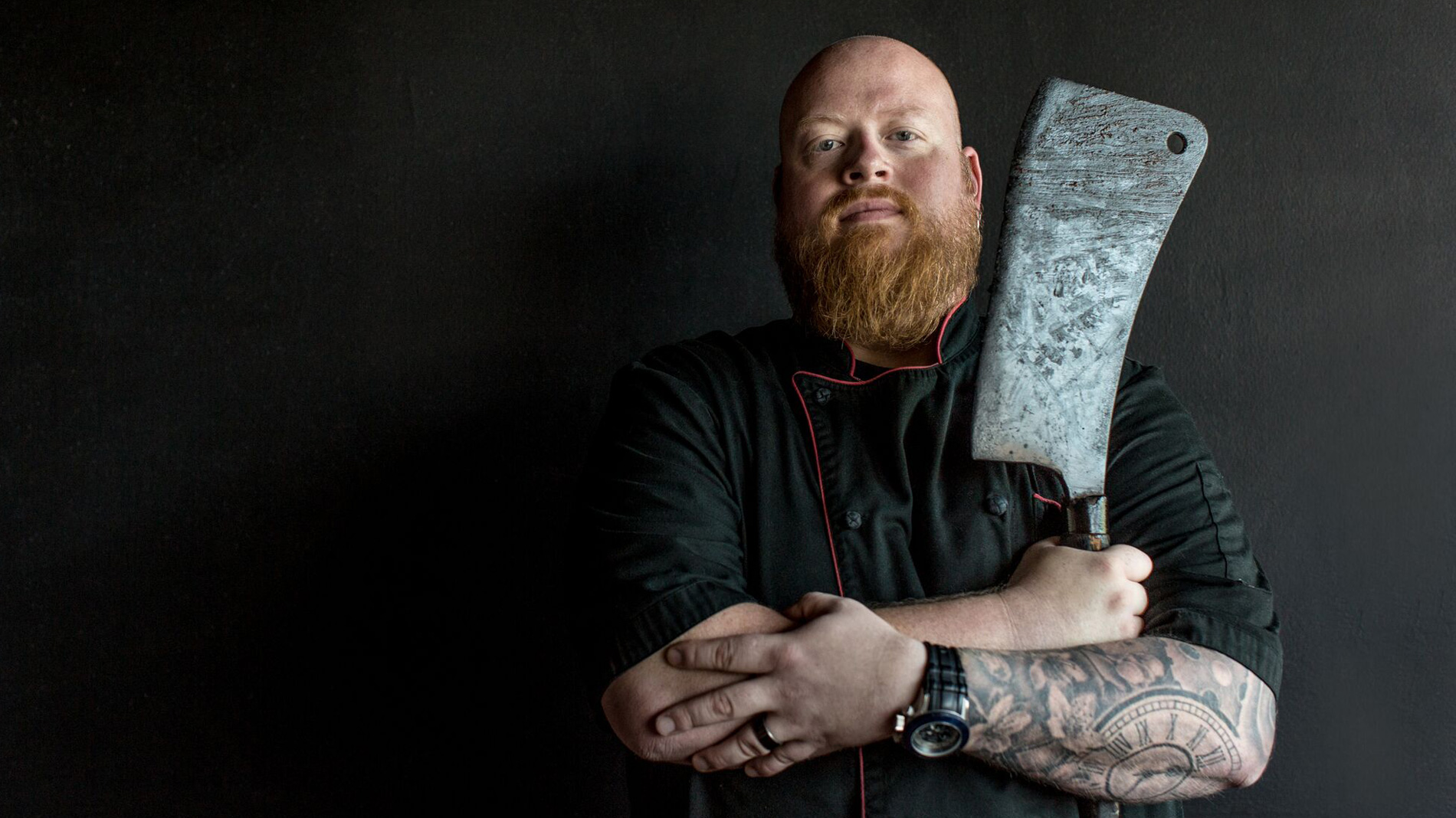beast craft bbq chef-owner david sandusky with a meat cleaver