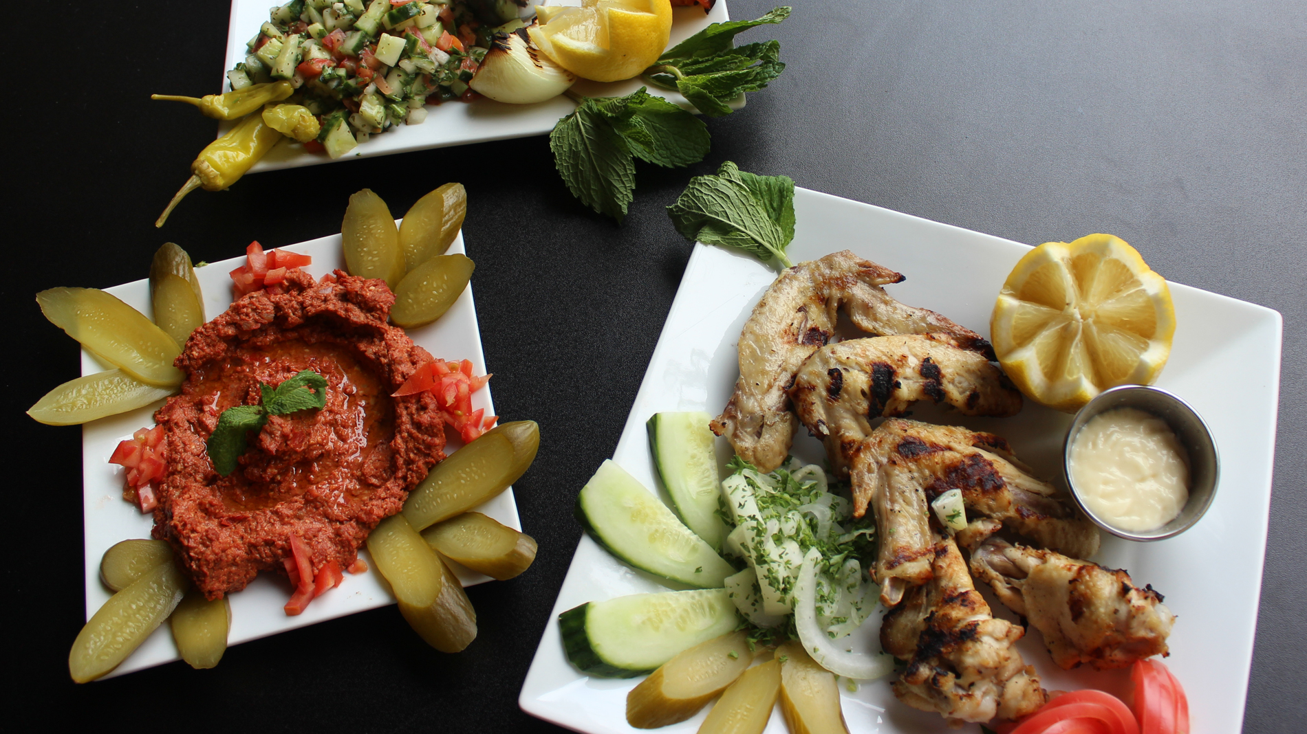 Levant Mixed Grill, grilled chicken wings and muhammara at levant in st. louis