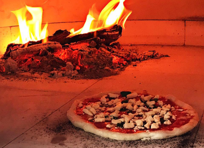 pie hard pizza in a wood-fired oven on truck