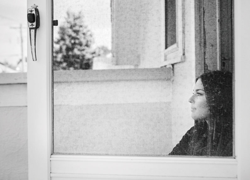 nina barbaglia sits on her porch on the hill in st. louis
