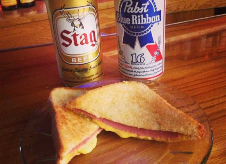 G&W bologna grilled cheese sammy and a cold can of beer from art bar