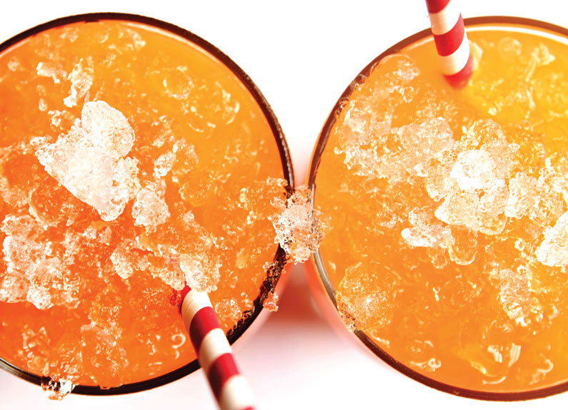 two orange cocktails with straws