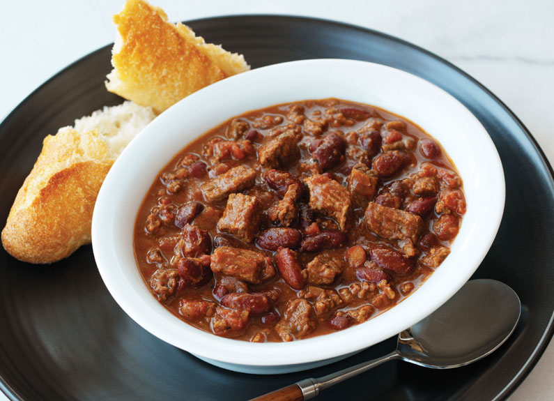 a bowl of chili with cornbread
