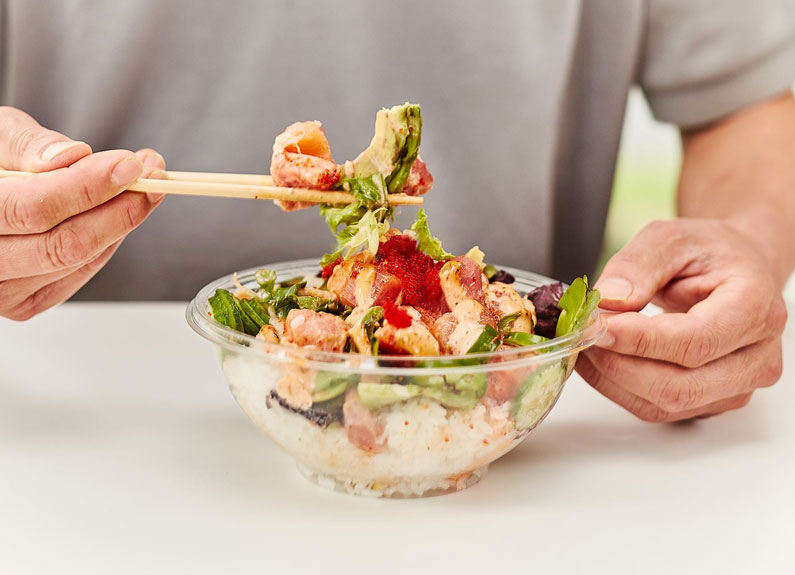 person eating a poke bowl